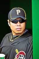 8 June 2010: Pittsburgh Pirates' infielder Akinori Iwamura stands in the dugout prior to a game against the prior to a game against the Washington Nationals at Nationals Park in Washington, DC. The Nationals defeated the Pirates 5-2 in the series opener where pitching sensation Stephen Strasburg made his Major League debut, striking out 14 batters and notching his first win in the majors. Mandatory Credit: Ed Wolfstein Photo