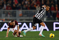 Calcio, quarti di finale di Coppa Italia: Roma vs Juventus. Roma, stadio Olimpico, 21 gennaio 2014.<br /> Juventus midfielder Arturo Vidal, of Chile, is chased by AS Roma forward Francesco Totti, left, during the Italian Cup round of eight final football match between AS Roma and Juventus, at Rome's Olympic stadium, 21 January 2014.<br /> UPDATE IMAGES PRESS/Riccardo De Luca