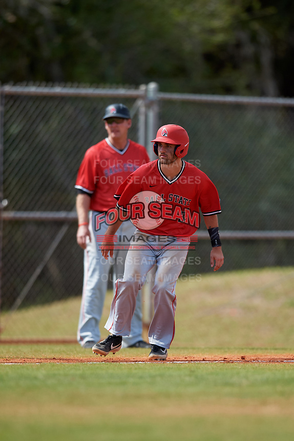 Ball State Cardinals William Baker (32) leads off third base in front of coach Rich Maloney during a game against the Mount St. Mary's Mountaineers on March 9, 2019 at North Charlotte Regional Park in Port Charlotte, Florida.  Ball State defeated Mount St. Mary's 12-9.  (Mike Janes/Four Seam Images)