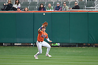 Center fielder Bryce Teodosio (13) of the Clemson Tigers catches a fly ball in a game against the South Alabama Jaguars on Opening Day, Friday, February 15, 2019, at Doug Kingsmore Stadium in Clemson, South Carolina. Clemson won, 6-2. (Tom Priddy/Four Seam Images)