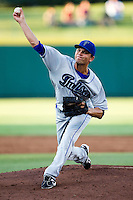 Josh Sullivan (13) of the Tulsa Drillers delivers a pitch during a game against the Springfield Cardinals at Hammons Field on July 18, 2011 in Springfield, Missouri. Tulsa defeated Springfield 13-8. (David Welker / Four Seam Images).