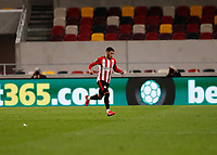 1st October 2020; Brentford Community Stadium, London, England; English Football League Cup, Carabao Cup Football, Brentford FC versus Fulham; Said Benrahma of Brentford runs towards his bench and celebrates after scoring his sides 3rd goal in the 77th minute to make it 3-0