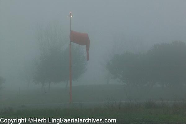 The wind sock hangs limp during a foggy morning at the Petaluma Municipal Airport, Petaluma, Sonoma County, California