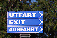 Signs saying exit in three languages, Swedish, Utfart, English, Exit, German, Ausfahrt at Astrid Lindgren's World. Vimmerby town Smaland region. Sweden, Europe.