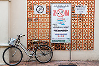 Bicycle Parked in front of No Parking Sign.  No Smoking Sign Prohibits Smoking in Heritage Area.  Melaka, Malaysia.
