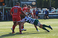Jake Upfield of Jersey Reds is tackled by Jordy Reid of Ealing Trailfinders during the Greene King IPA Championship match between Ealing Trailfinders and Jersey at Castle Bar, West Ealing, England  on 19 October 2019. Photo by Alan Stanford / PRiME Media Images