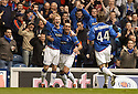22/10/2005         Copyright Pic : James Stewart.File Name : jspa02 rangers v motherwell.CHRIS BURKE CELEBRATES WITH FERNANDO RICKSEN AND ROSS MCCORMACK AFTER HE SCORES RANGERS FIRST IN THE FIRST MINUTE...Payments to :.James Stewart Photo Agency 19 Carronlea Drive, Falkirk. FK2 8DN      Vat Reg No. 607 6932 25.Office     : +44 (0)1324 570906     .Mobile   : +44 (0)7721 416997.Fax         : +44 (0)1324 570906.E-mail  :  jim@jspa.co.uk.If you require further information then contact Jim Stewart on any of the numbers above.........