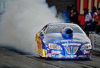 Oct. 31, 2008; Las Vegas, NV, USA: NHRA pro stock driver Warren Johnson does a burnout during qualifying for the Las Vegas Nationals at The Strip in Las Vegas. Mandatory Credit: Mark J. Rebilas-
