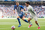 Isco Alarcon (r) of Real Madrid battles for the ball with Victor Camarasa Ferrando of Deportivo Alaves during their La Liga match between Real Madrid and Deportivo Alaves at the Santiago Bernabeu Stadium on 02 April 2017 in Madrid, Spain. Photo by Diego Gonzalez Souto / Power Sport Images