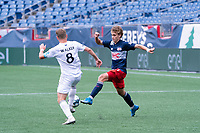 FOXBOROUGH, MA - JULY 4: Aaron Walker #8 of Greenville Triumph SC and Noel Buck #61 of the New England Revolution II compete for the ball during a game between Greenville Triumph SC and New England Revolution II at Gillette Stadium on July 4, 2021 in Foxborough, Massachusetts.