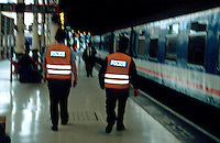 British Transport police officers on duty walking along the platform of a British Rail mainline station. This image may only be used to portray the subject in a positive manner..©shoutpictures.com..john@shoutpictures.com