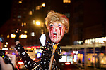 A demonstrator holds up a bloody Trump head on a stick during a protest demanding every vote cast be counted in the 2020 presidential election between U.S. President Donald Trump and former Vice President Joe Biden on November 4, 2020 in New York City.  Photograph by Michael Nagle