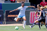 Chioma Igwe #12 of the Chicago Red Stars attempts to get a shot off against the defense of the Los Angeles Sol during their WPS game at The Home Depot Center on June 27,2009 in Carson, California.  The Sol defeated the Red Stars 4-0.