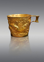 Vapheio type Mycenaean gold cup depicting a wild bull hunt side D, Vapheio Tholos Tomb, Lakonia, Greece. National Archaeological Museum of Athens.  Grey Background<br /> <br /> <br />  Two masterpieces of Creto - Mycenaean gold metalwork were excavated from a tholos tomb near Lakonia in Sparta in 1988. Made in the 15th century BC, the gold cups are heavily influenced by the Minoan style that was predominant in the Agean at the time. The bull hunt was popular with  Mycenaean  and Minoan artists and symolised power and fertility. The distinctive shape of the cup is kown as 'Vapheio type'.