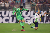 LAS VEGAS, NV - AUGUST 1: Paul Arriola #7 of the United States attempts to block Alfredo Talavera #1 of Mexico during a game between Mexico and USMNT at Allegiant Stadium on August 1, 2021 in Las Vegas, Nevada.