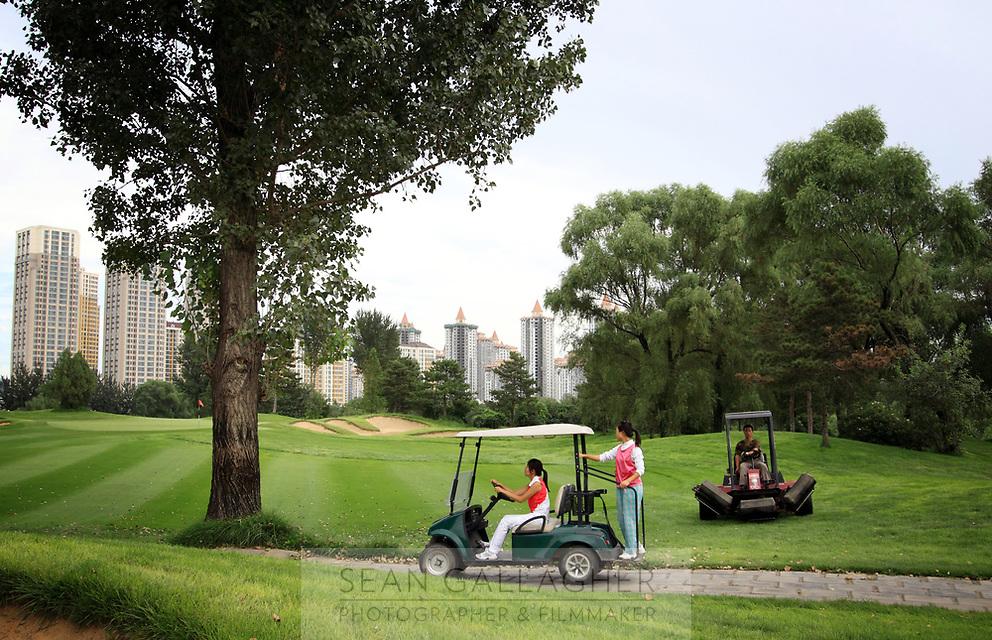 CHINA. Staff at the Huatang International Golf Club in Beijing. 2009