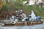 Tourists photographing jaguars. Cuiaba River. Porto Jofre, northern Pantanal, Mato Grosso State, Brazil. September