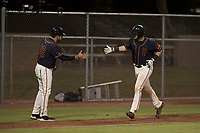 AZL Giants Black catcher Cody Brickhouse (6) is congratulated by manager Carlos Valderrama (32) after hitting a home run during an Arizona League game against the AZL Athletics at the San Francisco Giants Training Complex on June 19, 2018 in Scottsdale, Arizona. AZL Athletics defeated AZL Giants Black 8-3. (Zachary Lucy/Four Seam Images)
