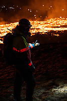 A member of ICE-SAR holds his gas meter. The volcanic gases get harmfull with levels over 1.0. A volcanic eruption in the Reykjanes peninsula started on 19 march 2021. The eruption in the area of Geldingadalir is considered small but some geologists are predicting it might be active for months or years to come. It takes around 90 minutes to to hike to the eruption from the road and since erupting people have been sightseeing.
