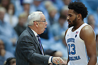 CHAPEL HILL, NC - JANUARY 4: Head coach Roy Williams and Jeremiah Francis #13 of the University of North Carolina during a game between Georgia Tech and North Carolina at Dean E. Smith Center on January 4, 2020 in Chapel Hill, North Carolina.