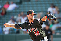 Ryan Arrowood (18) of the Albuquerque Isotopes delivers a pitch to the plate against the Salt Lake Bees in Pacific Coast League action at Smith's Ballpark on June 8, 2015 in Salt Lake City, Utah.  The Bees defeated the Isotopes 10-7 in game one of a double-header.Stephen Smith/Four Seam Images)