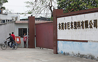 A closed factory is seen at the edge of the Yue Yuen Industrial Holdings Limited factory in Dongguan, Guangdong Province, China, 03 March 2015.