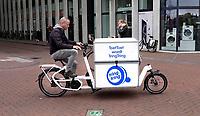 Nederland - Amsterdam- 2020. ToetToet wordt TringTring. Foto mag niet in negatieve / schadelijke context gepubliceerd worden. TringTring is gespecialiseerd in de bevoorrading van (horeca) ondernemingen in de binnenstad van grote steden. Als pioniers op het gebied van vervoer per bakfiets zijn zij al jaren bezig met het oplossen van een steeds groter wordend logistiek probleem: het autoluw worden van stadscentra. Foto ANP / HH / Berlinda van Dam