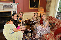A group of wedding guests at an exclusive private club reception.