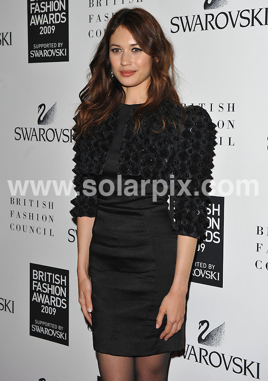 **ALL ROUND PICTURES FROM SOLARPIX.COM**.**WORLDWIDE SYNDICATION RIGHTS**.Press room and backstage at the British Fashion Awards 2009.  Held at the Royal Courts of Justice, Strand, London, UK.  9 December 2009..This pic: Olga Kurylenko..JOB REF: 10368 SSD     DATE: 09_12_2009.**MUST CREDIT SOLARPIX.COM OR DOUBLE FEE WILL BE CHARGED**.**MUST NOTIFY SOLARPIX OF ONLINE USAGE**.**CALL US ON: +34 952 811 768 or LOW RATE FROM UK 0844 617 7637**