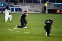 SAN JOSE, CA - SEPTEMBER 05: Chris Wondolowski #8 and Jackson Yueill #14 kneel during a game between Colorado Rapids and San Jose Earthquakes at Earthquakes Stadium on September 05, 2020 in San Jose, California.