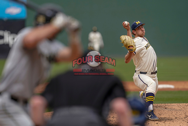Steve Hajjar (27) of the Michigan Wolverines delivers a pitch in a game against the Purdue Boilermakers on Friday, March 12, 2021, at Fluor Field at the West End in Greenville, South Carolina. (Tom Priddy/Four Seam Images)