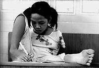 Tu Du Hospital - Ho Chi Minh City / Vietnam.<br /> Conseguenza della guerra in Vietnam 40 anni dopo.Nell'aula adibita allo studio dei 'lungo-degenti' incontro Pham Thi Thuy Linh. Ha 12 anni ed è nata senza braccia. Scrive e lavora al computer usando i piedi.<br /> Foto Livio Senigalliesi.<br /> Tu Du Hospital - Ho Chi Minh City / Vietnam.Consequenses of the war in Vietnam 40 years later.In the picture Pham Thi Thuy Linh (12) born in Kontum, one of the places most contaminated along Ho Chi Mihn trail.<br /> Photo Livio Senigalliesi