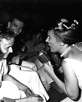"""Twenty-one year old James R. Gould is the envy of 3,000 crewmemberrs as television actress Kathleen Nolan singles him out for a song.  The young sailor and Bon Homme Richard both celebrated their """"coming of age"""" on November 26, 1965. (USIA)<br /> NARA FILE #:  306-MVP-8-6<br /> WAR & CONFLICT BOOK #:  392"""