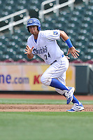 Cheslor Cuthbert #24 of the Omaha Storm Chaser runs to second base against the Las Vegas 51s at Werner Park on August 17, 2014 in Omaha, Nebraska. The Storm Chasers  won 4-0.   (Dennis Hubbard/Four Seam Images)