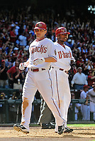 Apr. 5, 2010; Phoenix, AZ, USA; Arizona Diamondbacks shortstop Stephen Drew (left) and outfielder Justin Upton against the San Diego Padres during opening day at Chase Field. Mandatory Credit: Mark J. Rebilas-