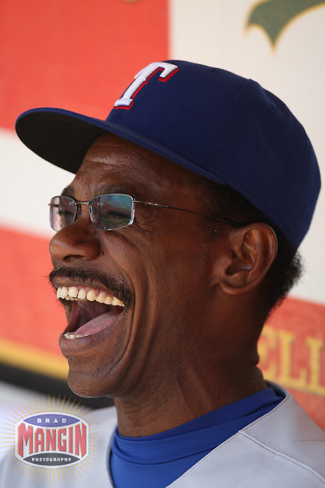 OAKLAND - JULY 18:  Manager Ron Washington of the Texas Rangers laughs in the dugout before the game against the Oakland Athletics at McAfee Coliseum in Oakland, California on July 18, 2007.  Photo by Brad Mangin