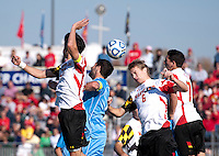 Helge Leikvang (6) of Maryland heads the ball away with Jordan Gafa (14) of North Carolina nearby in the box during the game at the Maryland SoccerPlex in Germantown, MD. Maryland defeated North Carolina, 2-1,  to win the ACC men's soccer tournament.