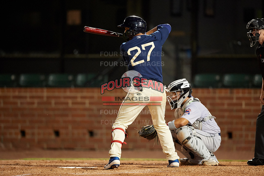 Mobile BayBears Roberto Baldoquin (27) at bat in front of catcher Rodrigo Vigil (1) during a Southern League game against the Jacksonville Jumbo Shrimp on May 7, 2019 at Hank Aaron Stadium in Mobile, Alabama.  Mobile defeated Jacksonville 2-0.  (Mike Janes/Four Seam Images)