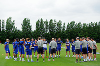 QPR manager Harry Redknapp addresses his team on the first day back of training