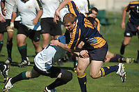 A NAVY player evades Colorado State University defenders during the match between the two rugby teams at the San Diego Invitational Tournament at Rob Field in Ocean Beach, San Diego, Thursday February 7 2008.  Navy won the match 17 -10 with a late converted try.  The tournament is being held  in conjunction with the USA 7?s International Rugby at PETCO Park on February 9th & 10th.