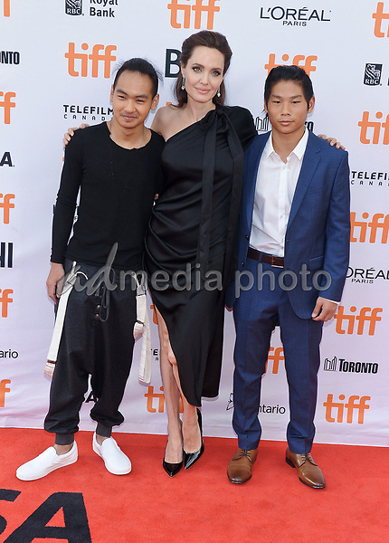 """11 September 2017 - Toronto, Ontario Canada - Maddox Jolie-Pitt, Angelina Jolie, Pax Jolie-Pitt. 2017 Toronto International Film Festival - """"First They Killed My Father"""" Premiere held at Princess of Wales Theatre. Photo Credit: Brent Perniac/AdMedia"""