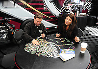 Jun. 19, 2011; Bristol, TN, USA: NHRA top fuel dragster driver Del Worsham and wife Connie Worsham do a puzzle during a rain delay to eliminations at the Thunder Valley Nationals at Bristol Dragway. Mandatory Credit: Mark J. Rebilas-
