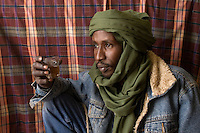 Tripoli, Libya - Ali, a Tuareg Tailor, Stops for Tea in Tripoli Medina (Old City).  His dress combines traditional male veil (tagulmust) with Western denim jacket.