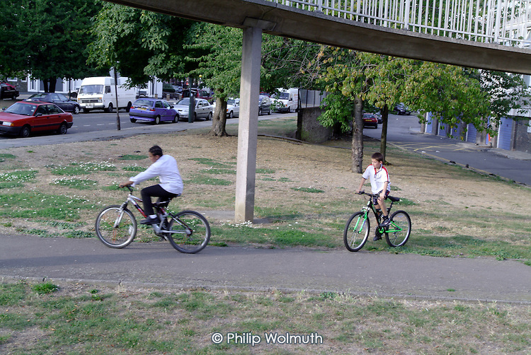 Boys play on the South Kilburn Estate in the London Borough of Brent. Residents are resisting proposals to finance regeneration of the run down estate by building an extra 2,400 flats.