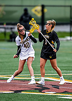 17 April 2021: UMBC Retriever Midfielder Megan Halczuk, a Sophomore from Fawn Grove, PA, faces off against University of Vermont Catamount Midfielder Jen Williams, a Junior from St. Louis, MO, at Virtue Field in Burlington, Vermont. The Lady Cats fell to the Retrievers 11-8 in the America East Women's Lacrosse matchup. Mandatory Credit: Ed Wolfstein Photo *** RAW (NEF) Image File Available ***
