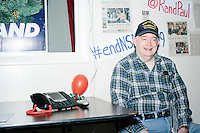 Rand Paul supporter Barry Devine, of Goffstown, NH, sits near the phonebank at the campaign headquarters of Kentucky senator and Republican presidential candidate Rand Paul during a celebration at his campaign headquarters in Manchester, New Hampshire. Paul was visiting the office to greet supporters and staff at the time.