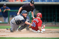 Lakeland Flying Tigers catcher Kade Scivicque (28) tags out Derek Campbell (26) sliding into home as umpire Dave Attridge looks on to make the call during a game against the Clearwater Threshers on August 5, 2016 at Bright House Field in Clearwater, Florida.  Clearwater defeated Lakeland 3-2.  (Mike Janes/Four Seam Images)