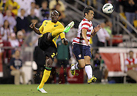 COLUMBUS, OHIO - SEPTEMBER 11, 2012:  Herculez Gomez (9) of the USA MNT turns away as Nyron Nosworthy (2) of  Jamaica boots the ball upfield during a CONCACAF 2014 World Cup qualifying  match at Crew Stadium, in Columbus, Ohio on September 11. USA won 1-0.