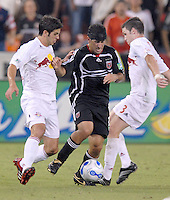 US Open Cup Quarterfinal, United's Alecko Eskandarian (11) tries to dribble the ball while being defended by Red Bulls' midfielder Danny O'Rourke (3). DC United defeated the New York Red Bulls 3-1, Wednesday, August 23, 2006 at RFK Stadium.