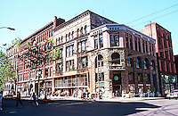 Seattle: Yesler Building, 28 MM, SW Corner 1st & Yesler, 1890-95. To left, Schwabacher Bldg. & Terky-Benny Bldg., 1889-90. Photo '86.